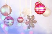 Christmas decorations hanging on festive background