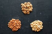 Different Types Of Nuts On Black Background