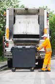 pic of garbage bin  - Worker of recycling garbage collector truck loading waste and trash bin - JPG