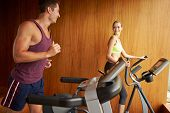 Couple Exercising Together In Home Gym