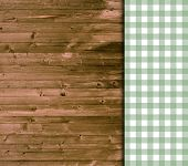 Wooden background with green tablecloth