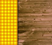Wooden background with orange tablecloth