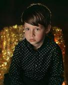 Portrait of a boy in a black shirt
