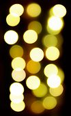 Circular bokeh lights background in golden tones