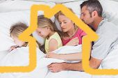 Parents sleeping in bed with their twins against house outline
