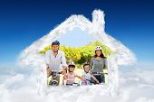 Family with their bikes against blue sky over clouds
