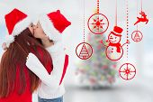 Mother and daughter hugging against blurry christmas tree in room