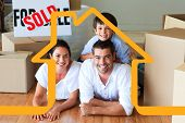 Family in their new house lying on floor with boxes against house outline