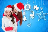 Mother and daughter with gift against blue snowflake design