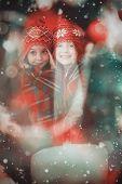Festive little girls under a blanket against candle burning against festive background