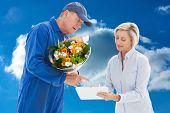 Happy flower delivery man with customer against cloudy sky