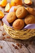 Delicious Muffins With Oranges And Raisins Close-up. Vertical
