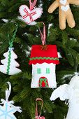 Christmas handmade decorations on Christmas tree background