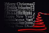 Red christmas tree ribbon against black