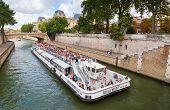 Seine River, White Passenger Tourist Ship In Paris