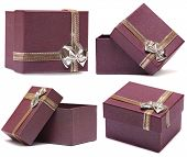 Set of four gift boxes purple with bow and ribbon isolated on white background.