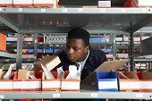 Factory Worker With Clipboard In Storeroom