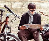 Man Cyclist With Map
