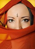 Young Beautiful Woman Eyes In Indian Traditional Jewellary, Bindi , Sari Dress And Makeup. Yellow Ba