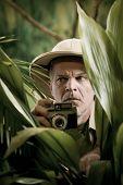 Explorer Photographer Hiding In Vegetation