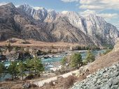 Katun River ( Altai Mountains ) on the background of rock