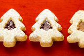 pic of linzer  - Linzer cookies in shape of Christmas tree on red background - JPG