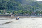 RURRENABAQUE, BOLIVIA, MAY 10, 2014 - Local people travel in traditional wooden boat on Beni river
