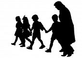 Silhouette of a mother and childs on the walk