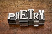 pic of poetry  - poetry word in mixed vintage metal type printing blocks over grunge wood - JPG