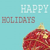 an ornamented red christmas ball and the text happy holidays on a blue background, in a pop art style