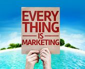 Every Thing is Marketing card with beach background