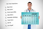 Portrait of a doctor holding a calendar against blue card
