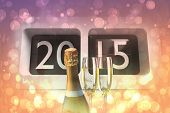 2015 alarm clock against sparkling wine