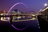 stock photo of tyne  - A quayside night shot of the Sage Gateshead framed by the Millennium Bridge - JPG