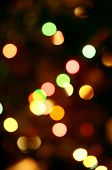 stock photo of twinkle  - Defocused colourful bokeh twinkling lights background  - JPG