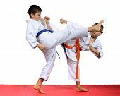 Boys sportsmen are training kicks legs