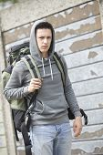stock photo of homeless  - Homeless Teenage Boy On Street With Rucksack - JPG