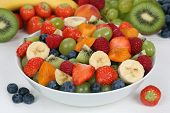 stock photo of apricot  - Fruit salad in a bowl with fruits like strawberries kiwi blueberries and apricots - JPG