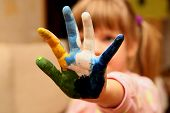 little girl with hands in paint