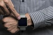 Business men are using smart phones and watches