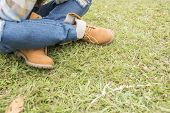 Beautiful girl in the park, close-up shoes
