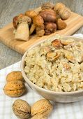 foto of porcini  - risotto with porcini mushrooms on wooden table - JPG