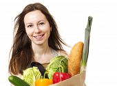 Young Woman Holding Large Bag Of Healthly Groceries - Stock Image