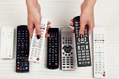 Many remote control devices in hands