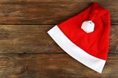 Santa red hat on wooden background