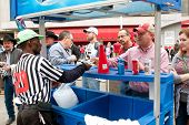 People Buy Beer From Outdoor Vendor At College Sports Event