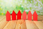 Paper houses on table on natural background