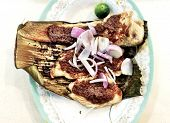 picture of stingray  - A signature Singaporean hawker dish of grilled stingray with sambal chili sauce - JPG