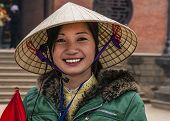 Young Vietnamese Woman With Traditional Hat.