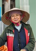 Middle-aged Vietnamese Woman With Traditional Straw Hat.